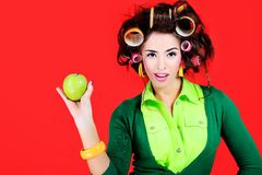 Housewife with an apple stock photography