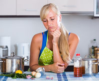 Housewife in apron standing at table Royalty Free Stock Images