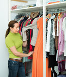 Housewife arranging clothes at wardrobe Royalty Free Stock Photo