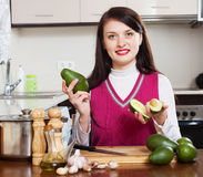 Housewife  with avocado. At home kitchen Stock Photo