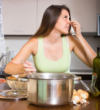 Housewife with bad smelling pan Royalty Free Stock Photo