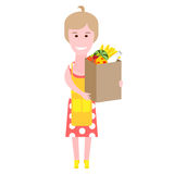 Housewife with a bag of food Royalty Free Stock Photography