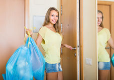 Housewife with bags of garbage indoor Stock Image