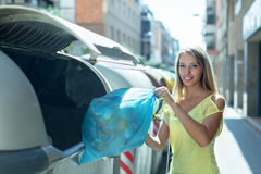 Housewife with bags of household garbage Royalty Free Stock Photo