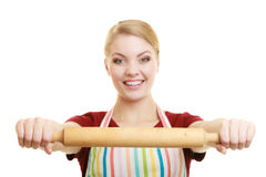 Housewife or baker chef holds baking rolling pin Stock Photo