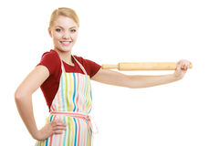 Housewife or baker chef holds baking rolling pin Royalty Free Stock Image