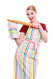 Housewife or baker chef wearing kitchen apron oven mitten holds baking rolling pin Stock Photo
