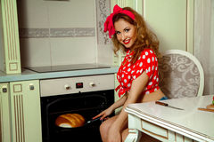 Housewife bakes bread at home kitchen Royalty Free Stock Photography