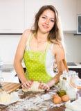 Housewife baking a bread Stock Photos