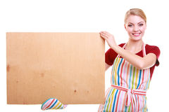 Housewife or barista in kitchen apron holds board empty blank sign isolated Stock Photography