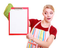 Housewife or barista in kitchen apron holds clipboard with empty blank isolated Royalty Free Stock Photography