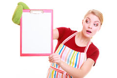 Housewife or barista in kitchen apron holds clipboard with empty blank isolated Stock Photos