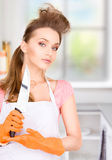Housewife with big knife Stock Photos