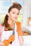 Housewife with big knife Royalty Free Stock Photography