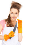 Housewife with big knife Stock Images