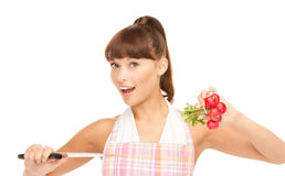 Housewife with big knife and radish Royalty Free Stock Image
