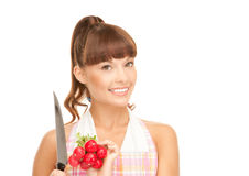 Housewife with big knife and radish Royalty Free Stock Images