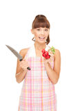 Housewife with big knife and radish Stock Photos