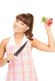 Housewife with big knife and radish Royalty Free Stock Photos