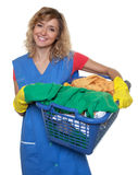 Housewife with blond hair and a basket of dirty clothes Stock Photography