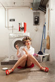 Housewife bored in the laundry Royalty Free Stock Images