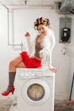 Housewife bored in the laundry Royalty Free Stock Photo