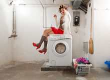 Housewife bored in the laundry Stock Images
