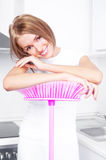 Housewife with a broom Royalty Free Stock Photos