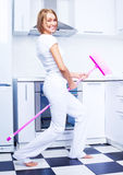 Housewife with a broom Stock Photos