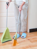 Housewife with broom and dustpan Royalty Free Stock Photography