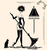 Housewife and a broom Royalty Free Stock Images