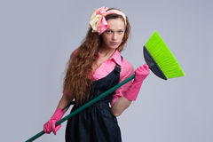 Housewife with broom Stock Photography