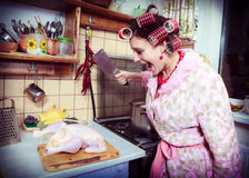 Housewife with butcher in hands and a hen Stock Image