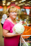 Housewife buying cabbage Royalty Free Stock Photography