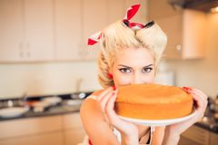 Housewife with a cake Royalty Free Stock Photos