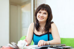 Housewife calculates the  budget Royalty Free Stock Photography