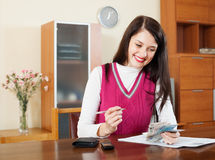 Housewife calculates the family budget Stock Photo