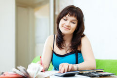 Housewife calculates family budget royalty free stock images
