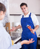 Housewife called professional plumber with tools to change  bibc Stock Photography