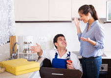 Housewife called professional plumber with tools to change  bibc Stock Photos