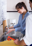 Housewife called professional plumber with tools to change  bibc Royalty Free Stock Photo