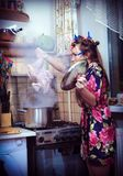 Housewife with carcass of a hen in hands Royalty Free Stock Photos
