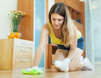 Housewife caring for parquet Stock Images