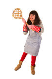 Housewife with carpet beater. Housewife is very aggressive with carpet beater royalty free stock image