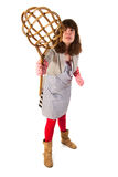 Housewife with carpet beater. Housewife is very aggressive with carpet beater royalty free stock photography