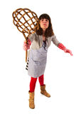 Housewife with carpet beater. Housewife is very aggressive with carpet beater royalty free stock photo