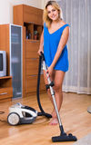 Housewife in casual hoovering at home Royalty Free Stock Image