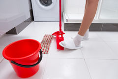 Housewife changing the cloth on the mop Stock Image