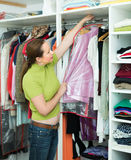 Housewife checking apparel at home Stock Photography