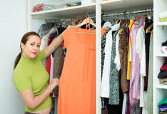 Housewife checking apparel at home Stock Images